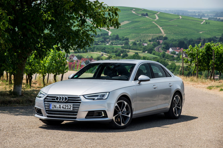 Silver 2017 Audi A4 with green hills