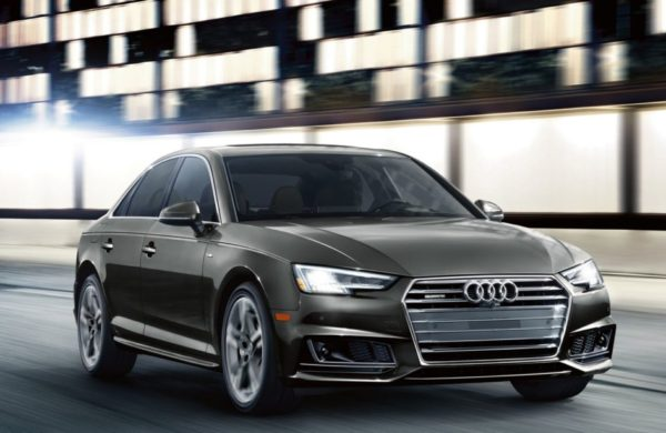 2017 Audi A4 driving down a road