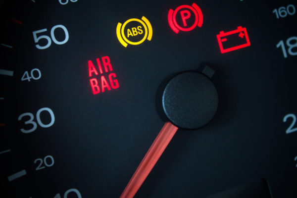 airbag warning light. car dashboard in closeup