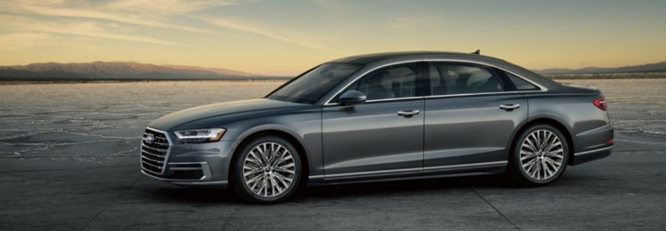 Silver 2019 Audi A8 parked in a sunny desert valley.