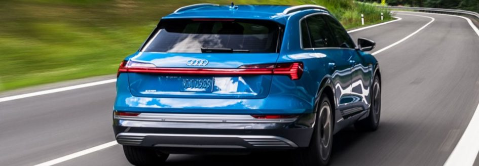 2019 audi e tron driving through the country side