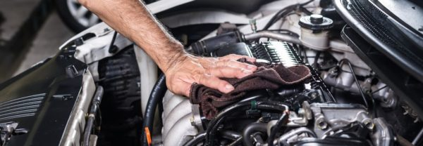 a car mechanic under the hood of a vehicle